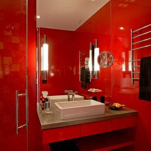Foto de cuarto de baño minimalista con lavabo sobreencimera, armarios con paneles lisos, puertas de armario rojas, encimera de cemento, ducha a ras de suelo, sanitario de pared y paredes rojas