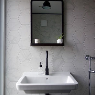 This is an example of a small scandi shower room bathroom in Other with a walk-in shower, a two-piece toilet, black and white tiles, porcelain tiles, white walls, porcelain flooring and a wall-mounted sink.