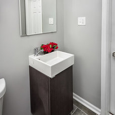 Transitional Bathroom by White Sand Properties, LLC.