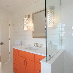 На фото: ванная комната в морском стиле с врезной раковиной, плоскими фасадами, оранжевыми фасадами, белой плиткой, плиткой кабанчик, белыми стенами и душевой кабиной с