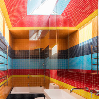 Inspiration for a contemporary multicolored tile and mosaic tile mosaic tile floor and black floor bathroom remodel in Sydney with a wall-mount sink