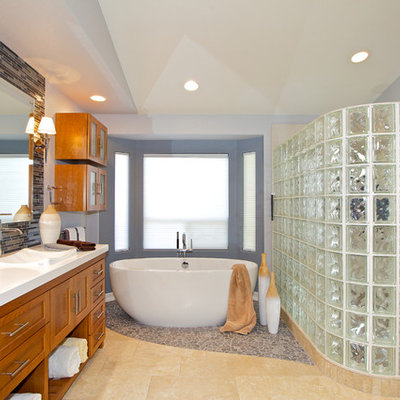 Inspiration for a contemporary mosaic tile and multicolored tile bathroom remodel in San Diego with a drop-in sink, shaker cabinets, medium tone wood cabinets and solid surface countertops