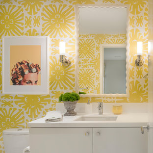 Mid-sized trendy master bathroom photo in San Francisco with flat-panel cabinets, white cabinets, a one-piece toilet, an undermount sink and yellow walls
