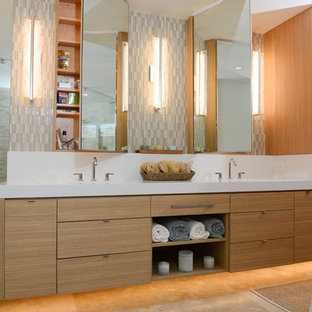 Example of a coastal multicolored tile and matchstick tile beige floor bathroom design in Hawaii with an undermount sink, flat-panel cabinets, light wood cabinets, blue walls and quartzite countertops