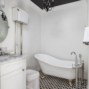 Claw-foot bathtub - coastal master multicolored floor and wallpaper claw-foot bathtub idea in Los Angeles with shaker cabinets, white cabinets, white walls, an undermount sink, gray countertops and a freestanding vanity