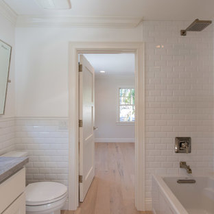 Bathroom - small mediterranean white tile and subway tile light wood floor bathroom idea in Miami with marble countertops and white walls