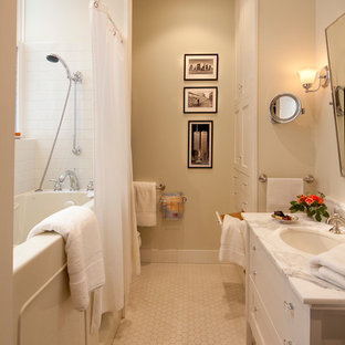 Elegant white tile and subway tile tub/shower combo photo in San Francisco with an undermount sink, flat-panel cabinets and white cabinets