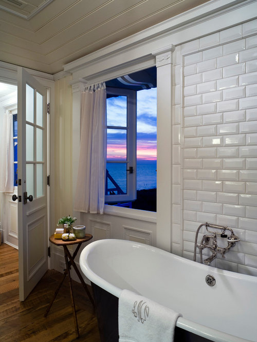 floor to ceiling subway tile bathroom. beach style white tile and subway dark wood floor freestanding bathtub idea in new york to ceiling bathroom