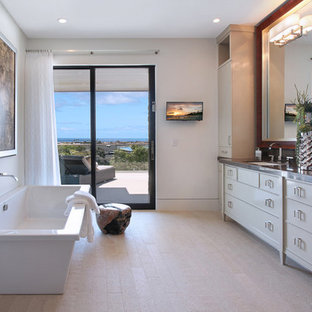 Inspiration for a contemporary beige floor and double-sink freestanding bathtub remodel in Los Angeles with flat-panel cabinets, beige cabinets, an undermount sink and gray countertops