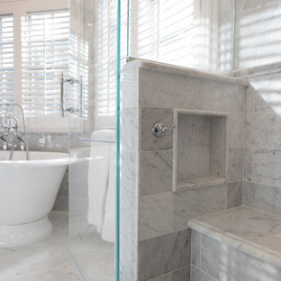 Large elegant master white tile and stone tile marble floor bathroom photo in New York with an undermount sink, marble countertops, a two-piece toilet, gray walls, beaded inset cabinets and white cabinets