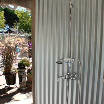 See an Outdoor Bathroom Made From a Water Tank