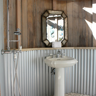Example of an eclectic pebble tile floor bathroom design in San Francisco with a pedestal sink