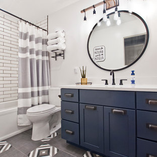 Inspiration for a small modern kids' white tile and porcelain tile porcelain floor and gray floor bathroom remodel in Nashville with shaker cabinets, blue cabinets, a two-piece toilet, white walls, an undermount sink, quartz countertops and white countertops