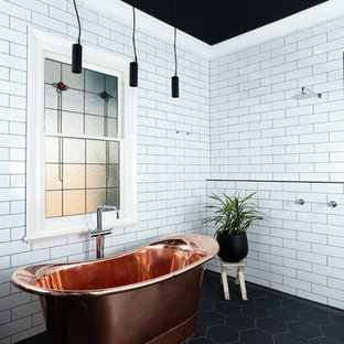 Inspiration for a contemporary master wet room bathroom in Melbourne with a freestanding tub, white tile, subway tile, porcelain floors, black floor, an open shower and white walls.