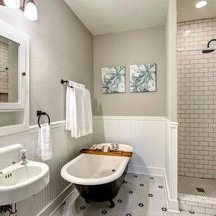 Elegant white tile bathroom photo in Houston with gray walls