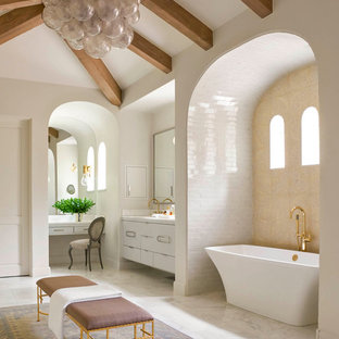 Inspiration for a mediterranean white tile and subway tile freestanding bathtub remodel in Dallas with flat-panel cabinets, white cabinets and white walls