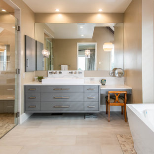 Example of a large mid-century modern master multicolored tile beige floor and porcelain floor bathroom design in Other with flat-panel cabinets, gray cabinets, beige walls, a trough sink, a hinged shower door, white countertops and quartzite countertops