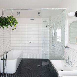 Bathroom - large contemporary master black tile, white tile and ceramic tile ceramic floor and gray floor bathroom idea in Philadelphia with a one-piece toilet, white walls and a wall-mount sink