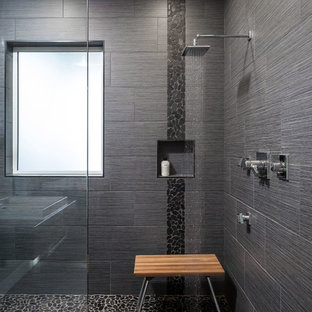 Design ideas for a large contemporary master bathroom in Other with an open shower, gray tile, porcelain tile, pebble tile floors, grey walls and an open shower.