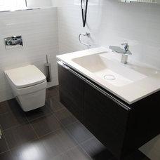 Contemporary Bathroom by Reflections Studio