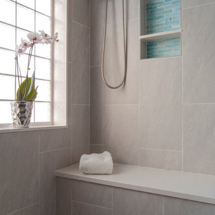 Inspiration for a large modern master gray tile and porcelain tile pebble tile floor doorless shower remodel in Philadelphia with gray walls