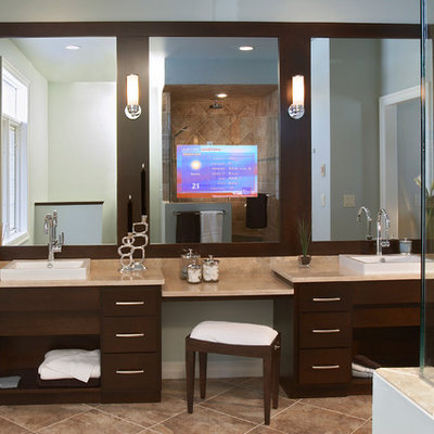 Alcove shower - mid-sized contemporary master beige tile and stone tile ceramic tile and brown floor alcove shower idea in Other with flat-panel cabinets, dark wood cabinets, gray walls, a drop-in sink, granite countertops and a hinged shower door