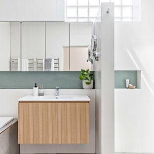 Mid-sized contemporary master bathroom in Sydney with medium wood cabinets, a drop-in tub, a corner shower, white tile, ceramic tile, white walls, porcelain floors, a wall-mount sink, grey floor and an open shower.