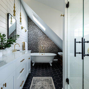Bathroom - cottage gray tile and white tile black floor bathroom idea in Seattle with white cabinets, white walls, an undermount sink, a hinged shower door, white countertops and recessed-panel cabinets