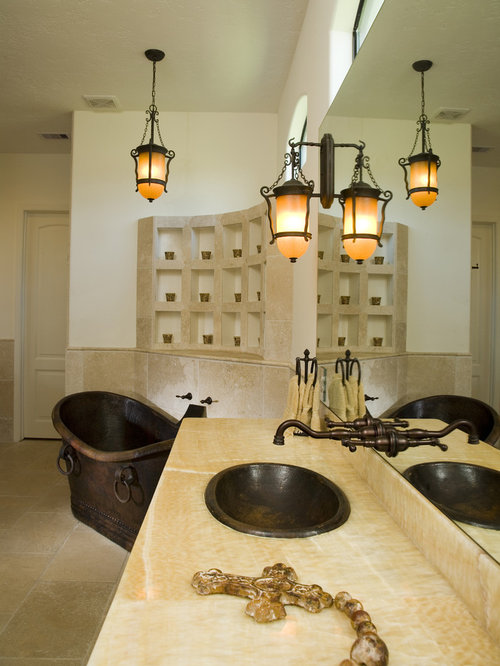 Inspiration For A Mediterranean Freestanding Bathtub Remodel In Houston  With Solid Surface Countertops
