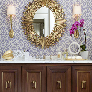 Trendy bathroom photo in San Francisco with furniture-like cabinets, purple walls and dark wood cabinets