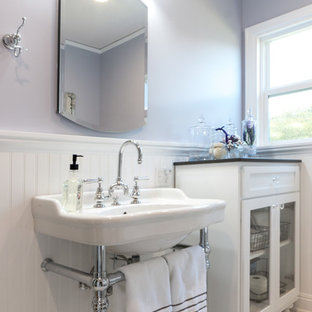 Bathroom - mid-sized shabby-chic style master white tile and subway tile porcelain floor and white floor bathroom idea in Los Angeles with a wall-mount sink, solid surface countertops, a hinged shower door, furniture-like cabinets, white cabinets, a two-piece toilet and gray walls