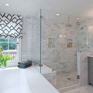 Example of a large transitional master gray tile and porcelain tile ceramic floor and multicolored floor bathroom design in Chicago with gray cabinets, a one-piece toilet, gray walls, a console sink, marble countertops, shaker cabinets and a hinged shower door