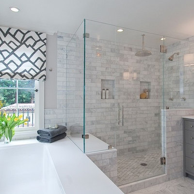 Example of a large transitional master gray tile and porcelain tile ceramic tile and multicolored floor bathroom design in Chicago with gray cabinets, a one-piece toilet, gray walls, a console sink, marble countertops, shaker cabinets and a hinged shower door