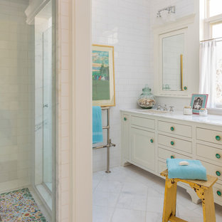 Design ideas for a large traditional master bathroom in Los Angeles with shaker cabinets, white cabinets, marble benchtops, white tile, subway tile, an undermount sink, a corner shower, marble floors and white floor.