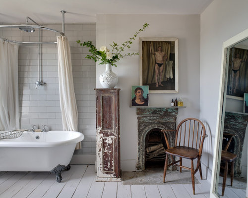Foot Tub White Tile Subway Walls And Painted Wood Floors