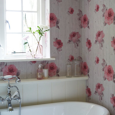 Example of a small cottage chic master claw-foot bathtub design in Sussex with multicolored walls
