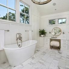 Farmhouse Bathroom by Simpson Design Group Architects