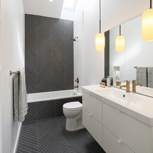 Contemporary bathroom in San Francisco with flat-panel cabinets, white cabinets, an alcove tub, a shower/bathtub combo, black and white tile, white walls, an integrated sink, black floor, an open shower and white benchtops.