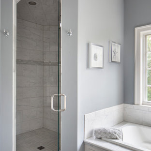 Mid-sized arts and crafts master white tile and marble tile porcelain tile and gray floor bathroom photo in Milwaukee with flat-panel cabinets, white cabinets, gray walls, an undermount sink, quartz countertops, a hinged shower door and white countertops