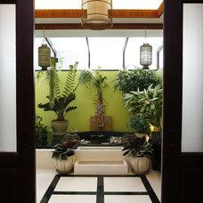 Asian Bathroom by Peti Lau Inc.
