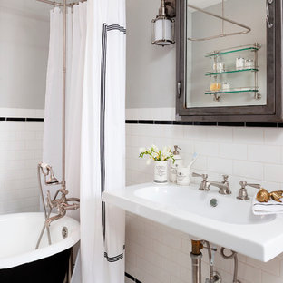 Small eclectic porcelain tile and black and white tile mosaic tile floor bathroom photo in DC Metro with a wall-mount sink and gray walls