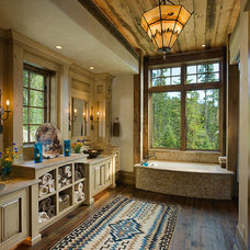 Rustic Bathroom by BLUE RIBBON BUILDERS INC