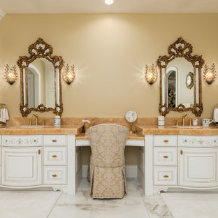 Inspiration for a large timeless master marble floor and white floor bathroom remodel in Salt Lake City with white cabinets, beige walls, an undermount sink, beige countertops and furniture-like cabinets