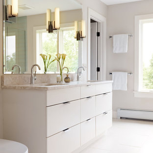Example of a trendy white tile bathroom design in Burlington with flat-panel cabinets, white cabinets and beige countertops