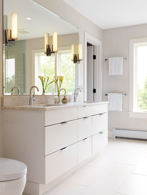 Example Of A Trendy White Tile Bathroom Design In Burlington With Flat Panel Cabinets And