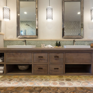 Example of a large coastal master multicolored tile and terra-cotta tile terra-cotta floor bathroom design in Los Angeles with a vessel sink, flat-panel cabinets, medium tone wood cabinets, wood countertops and beige walls