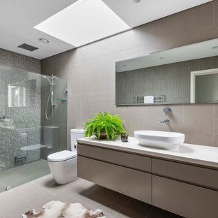 Contemporary bathroom in Sydney with flat-panel cabinets, grey cabinets, an alcove shower, gray tile, a vessel sink, grey floor, an open shower and white benchtops.