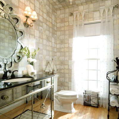 Example of an eclectic bathroom design in DC Metro with an undermount sink and furniture-like cabinets