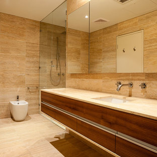 Example of a tuscan stone tile travertine floor double shower design in Perth with an integrated sink, flat-panel cabinets, medium tone wood cabinets, limestone countertops and a two-piece toilet