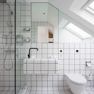 Photo of a medium sized contemporary ensuite bathroom in London with glass-front cabinets, a walk-in shower, black and white tiles, ceramic tiles, white walls, light hardwood flooring, white floors, a wall mounted toilet, a wall-mounted sink and an open shower.